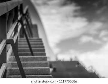 Black and White perspective shot of a hand rail and steps
