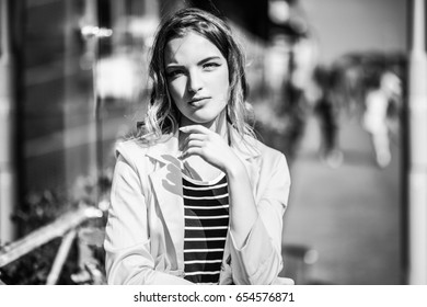 Black and white photo. Beautiful girl posing in urban locations