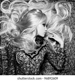 Black and white photo of  beautiful woman with magnificent hair