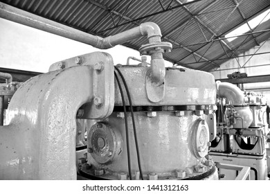Black & white photo of big industrial machine in old tin mine factory