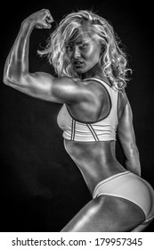 Black and white photo of a blonde bodybuilder