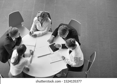 Black and white photo of business people on meeting