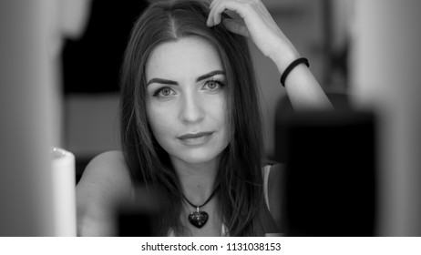 Black and white photo of charming brunette