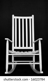 Black And White Photo Of Classic White Rocking Chair