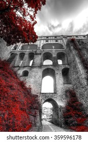 Black and white photo with the color red.  Cesky Krumlov, Czech republic