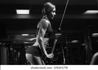 Black and white photo fitness woman in the gym. Young woman doing fitness exercises in the gym.