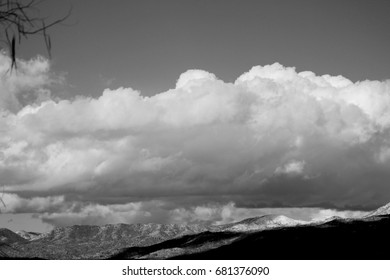 Black and white photo of gigantic monsoon cloud over the Catalina mountains in Tucson Arizona desert