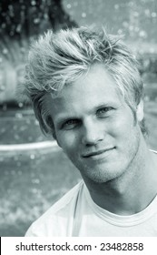 Black and white photo of good looking blond surfer guy.
