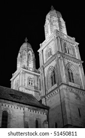 Black and white photo of a Grossmunster Cathedral at night (Zurich, Switzerland)