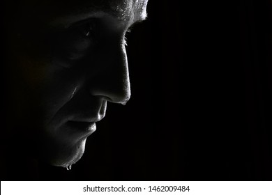 black and white photo half-face man with water drops or sweat