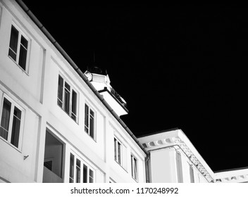 Black and white photo of the historic architecture in Miskolc, Hungary, Europe on at night.