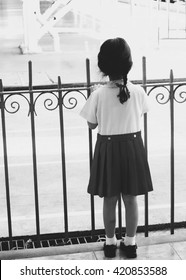 Black and white photo of little girl is waiting for going back home, silhouette