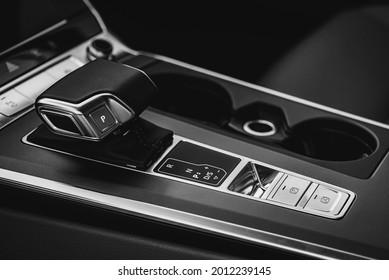 Black and white photo. Luxurious car interior. Car interior details. Happy interior. The concept of modern car interior design