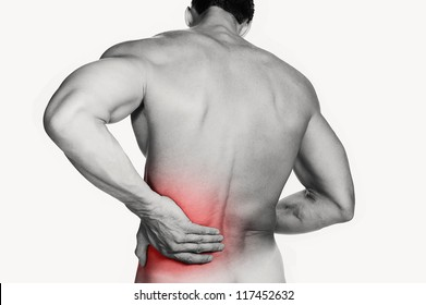 Black and white photo of a muscular man with a backache. Red selective color further illustrates pain.