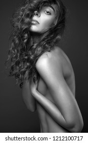 Black and white photo. naked girl with curly Hair. nude sexy Beautiful young woman