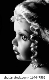 Black and white photo of,doll profile.