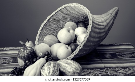 Black and white photo of an overflowing Cornucopia