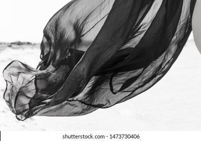 black and white photo pareo cape air flying light feather air wind blow sigh
