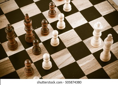 Black and white photo with a picture of a chess Board and chess pieces, Wooden chess pieces on a chess Board