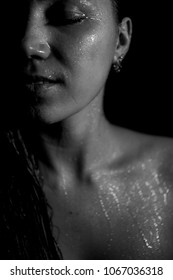 Black white photo. Portrait of a young beautiful woman close-up. A wet body