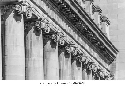 A black and white photo of a row ionic columns in Niagara Falls Canada.