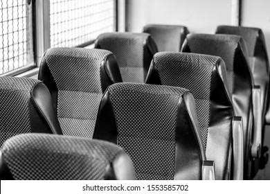 Black and white photo. Rows of Seats. Seats on the bus. Places for transporting prisoners.