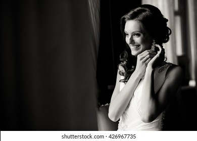Black and white photo of the smile of the bride