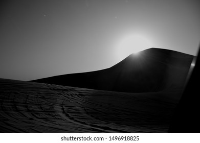 black and white photo of a sunset in the desert of Abu Dhabi