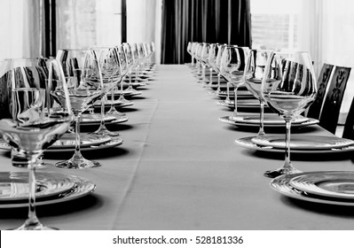 black and white photo. Table setting for a banquet or dinner party.