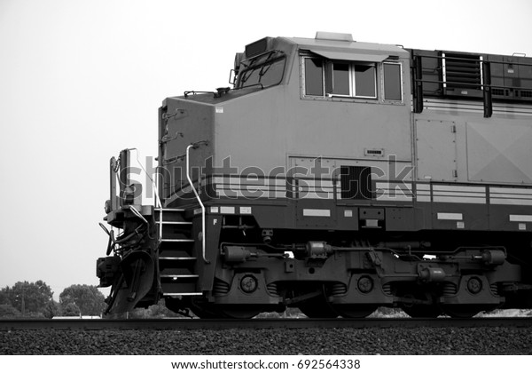 black and white photo of train on tracks