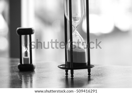 7f26dbec3d black and white photo of two difference size of vintage sandglass or  hourglass or egg timer