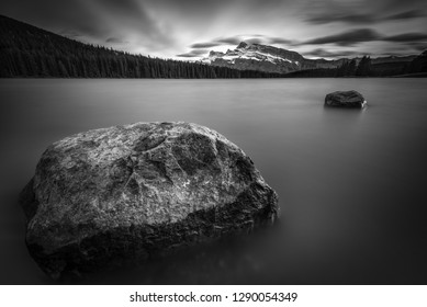 Black and white photo of Two Jack Lake in Banff National Park with Mt. Rundle in the distance.