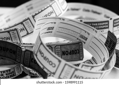 Black and white photo of unrolled raffle tickets