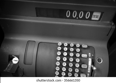black and white photo of vintage cash register