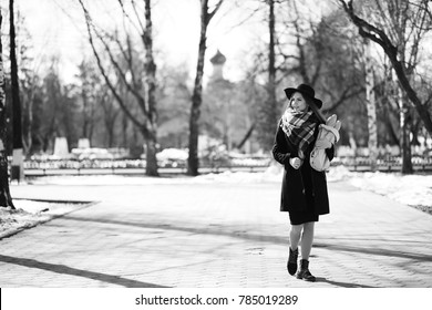 Black and white photo of a young girl on walk