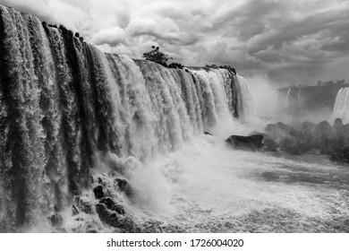 Black and white photograph of the Iguazu Falls, Brazil.