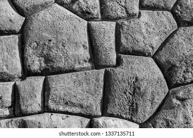Black and white photograph of the large granite blocks used in the construction of the Inca fortress of Sacsayhuaman, Cusco City, Peru.