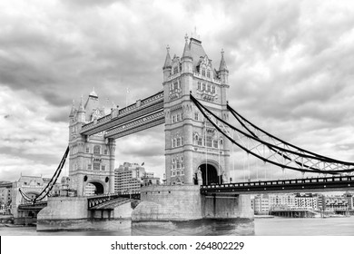 Black and white photograph of London Tower Bridge on the Thames River. It is an iconic symbol of London, United Kingdom.