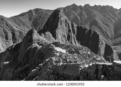 Black and white photograph of the Machu Picchu at sunrise near Cusco, Peru.