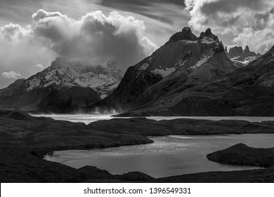 Black and white photograph with strong contrasts of Nordenskjold and Pehoe Lake during a strong wind storm in Torres del Paine national park, Patagonia, Chile.
