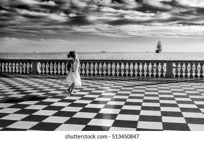 Black and White Photograph of Woman in Terrazza Mascagni, Livorno, Italy