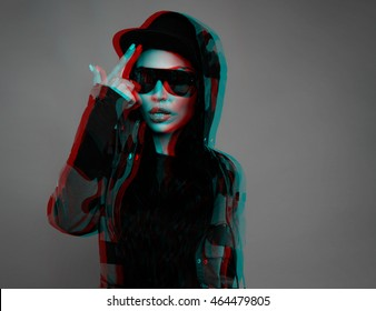 black and white photograph of a young girl of Asian appearance model which relates finger caps, camouflage jacket and sunglasses