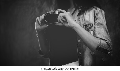 black and white  photographer girl  hold old Vintage camera lens  hipster Lifestyle  hobbies and leisure concept
