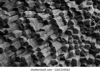 Black and white photography of basalt colums in Iceland. Iceland, rocks and natural phenomenon concepts.