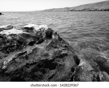 Black and white photography of coast with rocks and sea