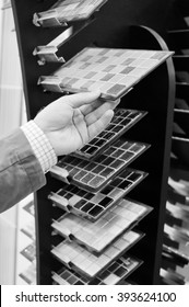 Black and white photography of hands choosing or presenting samples. Close up
