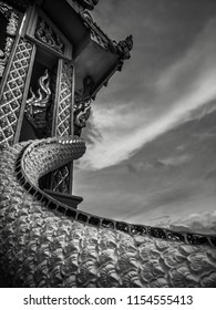 Black and white photography with lonely little buddhist white temple with nobody and dramatic cloudy sky in dark atmosphere, architecture of Thailand
