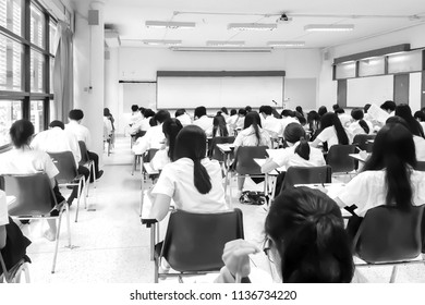Black and White photography of many Students are working on Class Examination at the University in Thailand.