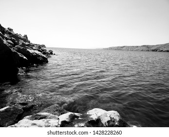 Black and white photography of sea with coast
