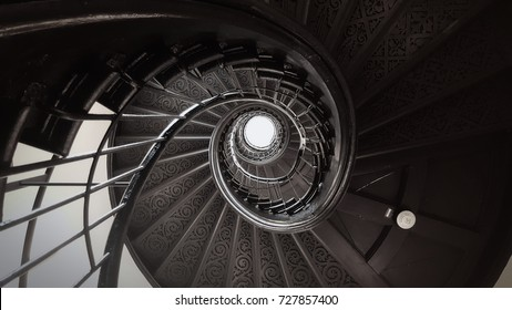 black and white photography of a spiral staircase